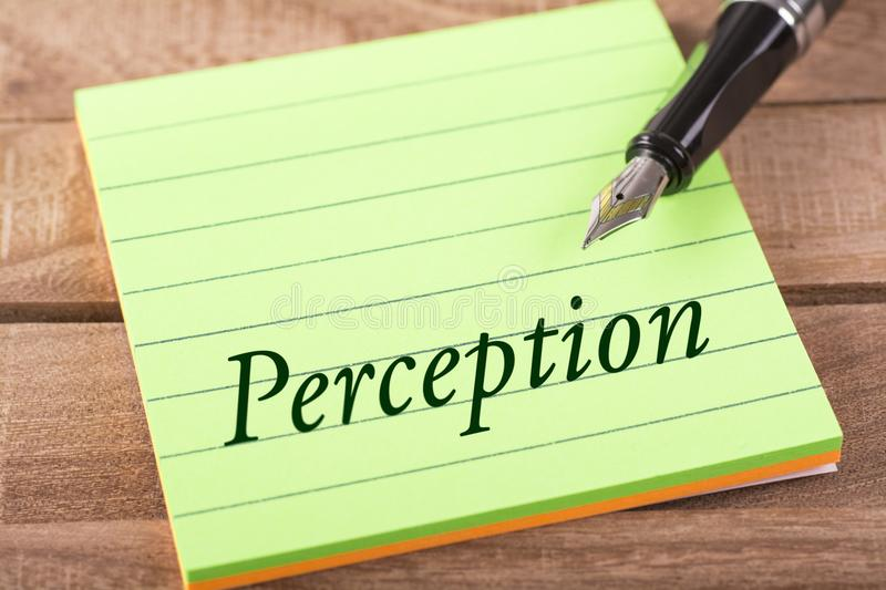 The word perception. Written in stick memo with fountain pen on wood royalty free stock photography