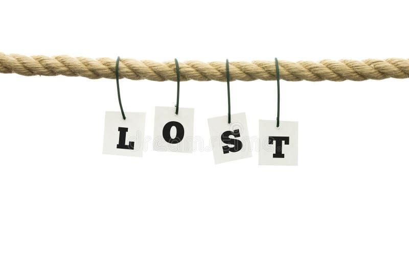 Word - perdu - pendant d'une corde au-dessus du blanc images stock