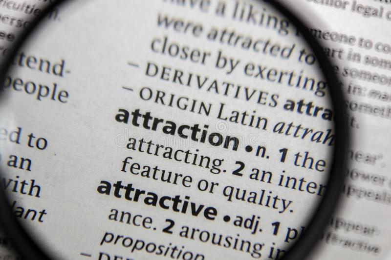 The word or phrase attraction in a dictionary stock photography