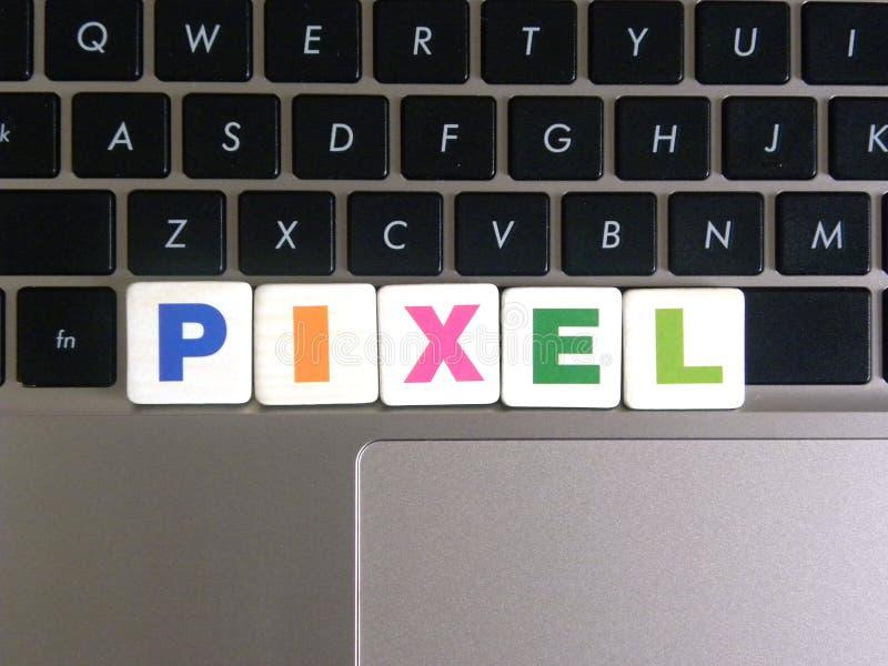 Word Pixel on keyboard background.  stock image