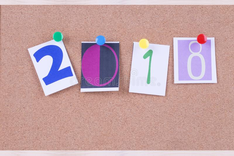 Word 2018 placed from colourful on the cork board,new year concept stock photography