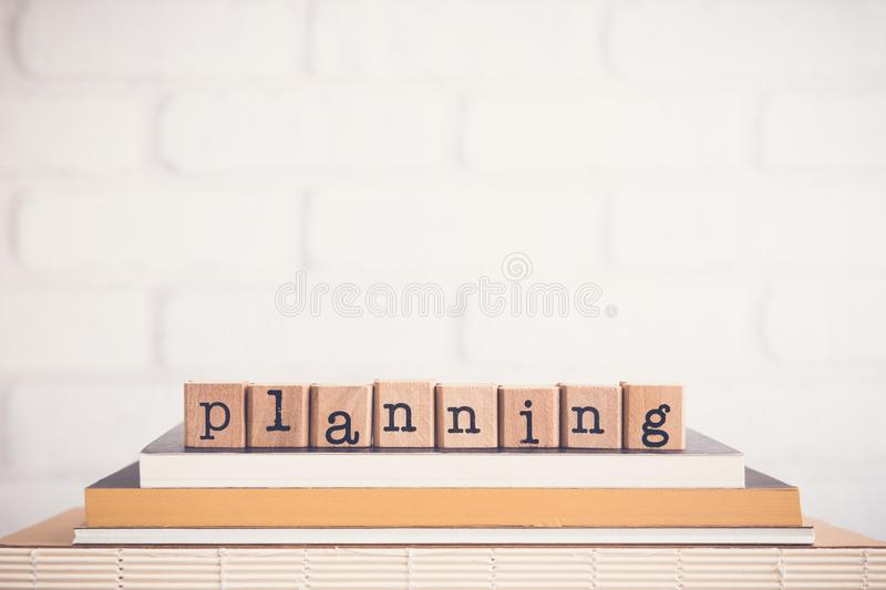 The word Planning and blank space background. stock image