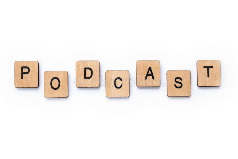 The word PODCAST. London, UK - June 12th 2019: The word PODCAST, spelt with wooden letter tiles over a white background royalty free stock photos