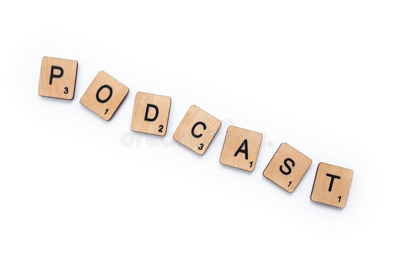 The word PODCAST. London, UK - June 12th 2019: The word PODCAST, spelt with wooden letter tiles over a white background stock image