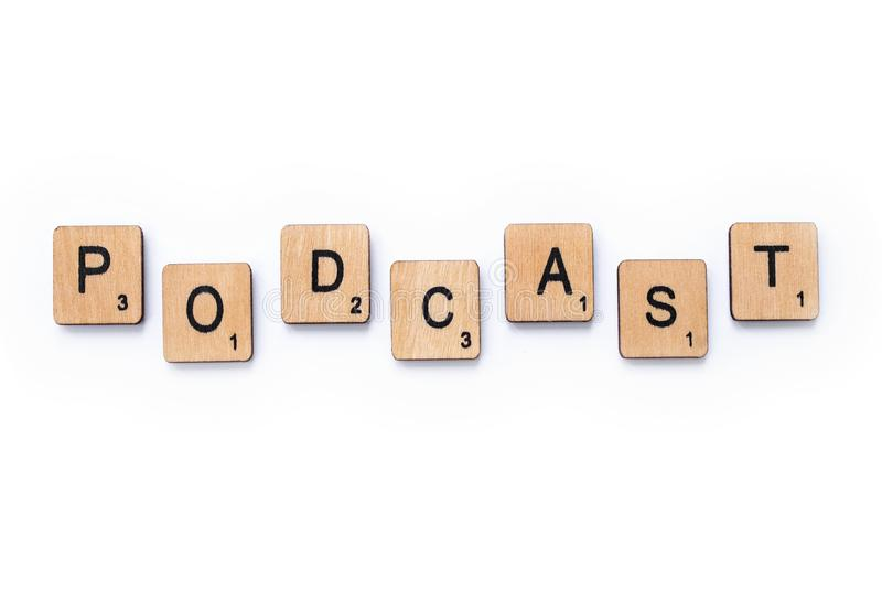 The word PODCAST. London, UK - June 12th 2019: The word PODCAST, spelt with wooden letter tiles over a white background stock photo