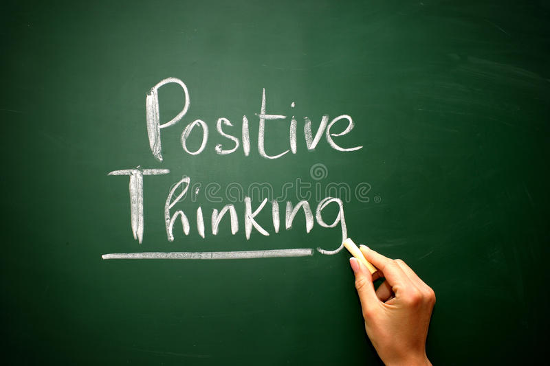 Word positive thinking drawn on a chalkboard,business concept royalty free stock images