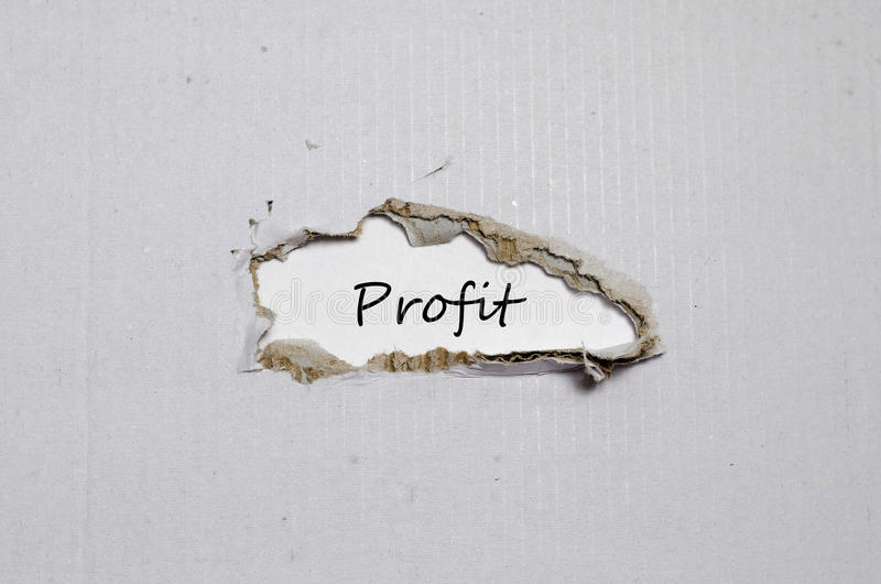 The word profit appearing behind torn paper royalty free stock photos