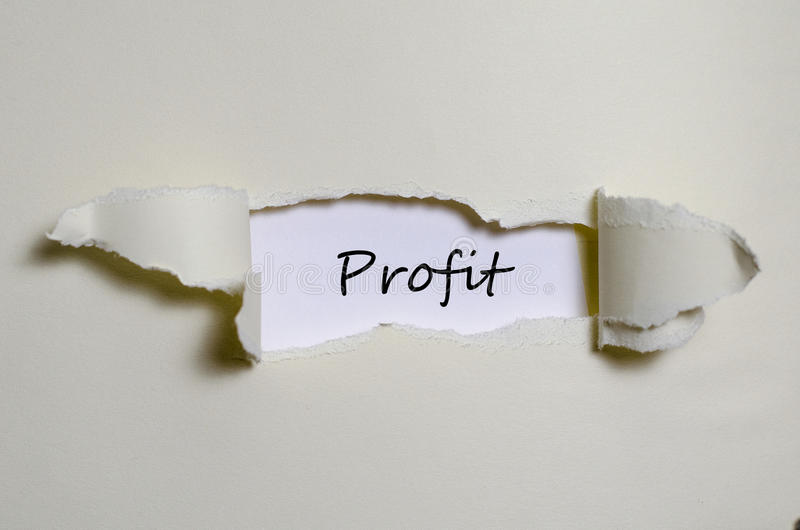 The word profit appearing behind torn paper stock photo