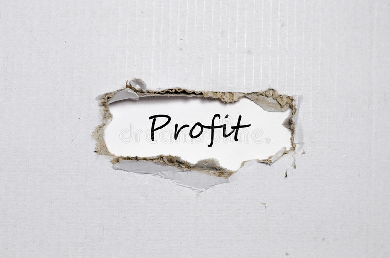 The word profit appearing behind torn paper stock images