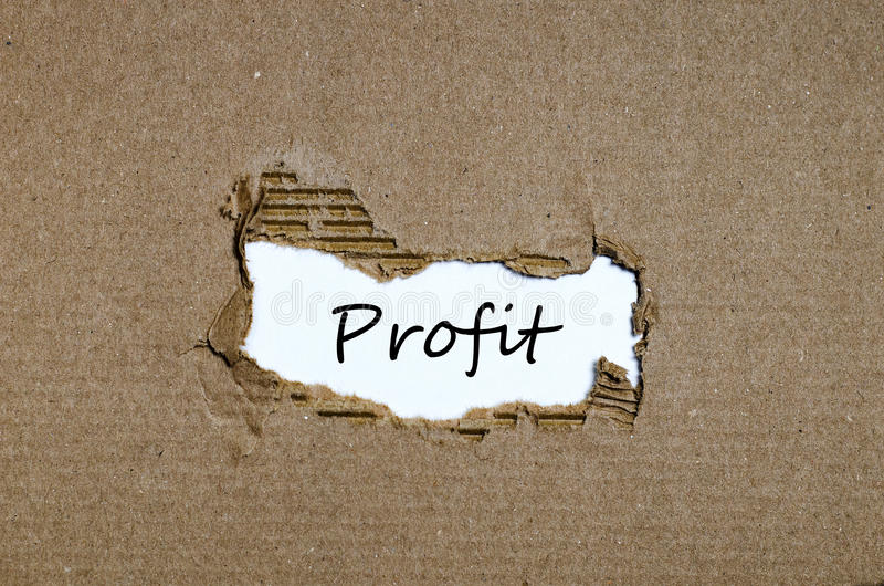The word profit appearing behind torn paper stock photos