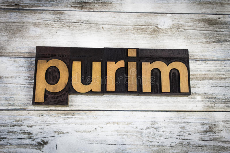 Purim Letterpress Word on Wooden Background stock photo