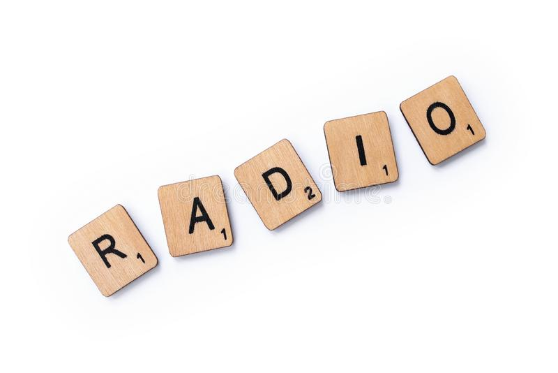 The word RADIO. London, UK - June 12th 2019: The word RADIO, spelt with wooden letter tiles over a white background royalty free stock photo