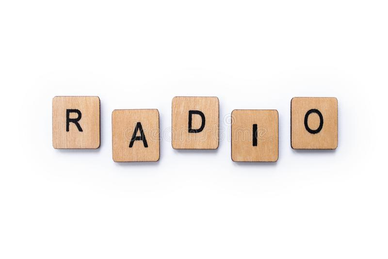 The word RADIO. Spelt with wooden letter tiles over a white background stock photos