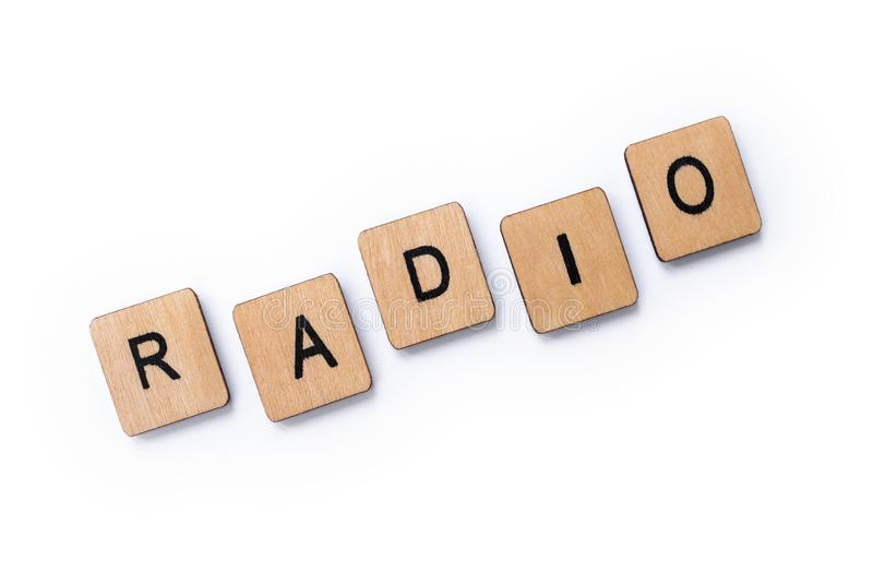 The word RADIO. Spelt with wooden letter tiles over a white background stock photo