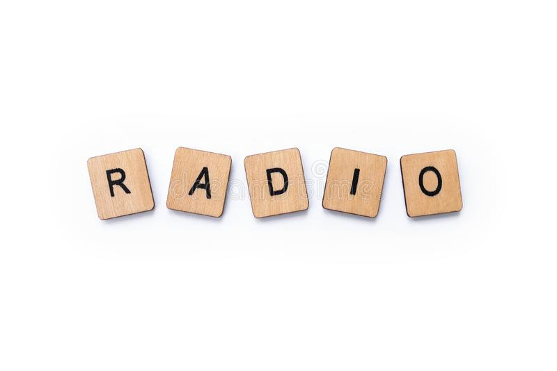 The word RADIO. Spelt with wooden letter tiles over a white background royalty free stock image