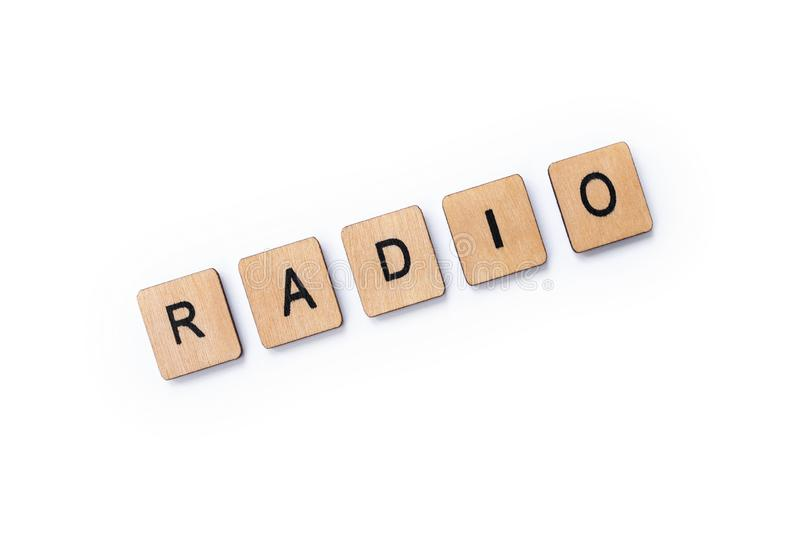 The word RADIO. Spelt with wooden letter tiles over a white background stock photography