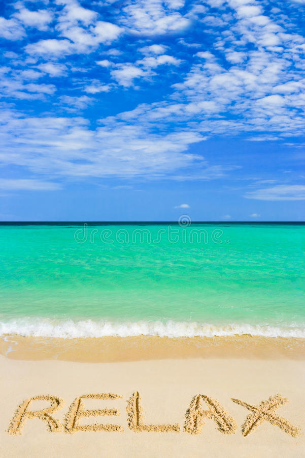 Word Relax on beach royalty free stock photo