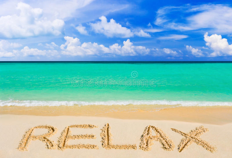 Word Relax on beach stock photography