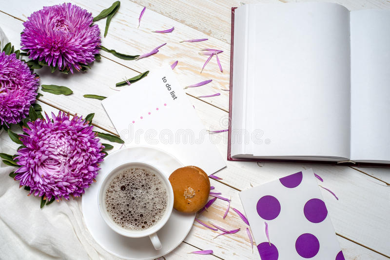 Word relax with cup of coffee and pink flowers. Word relax with book, cup of coffee and pink flowers. Copy space for text. greeting card royalty free stock photo