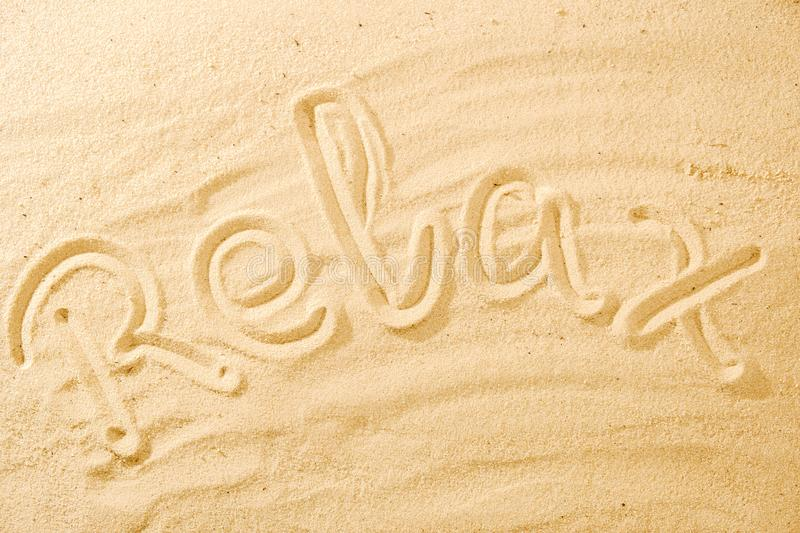 Word Relax on sand beach royalty free stock images