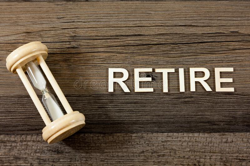 The word retire alongside a sand timer. Retirement Concept - The word retire alongside a sand timer royalty free stock image