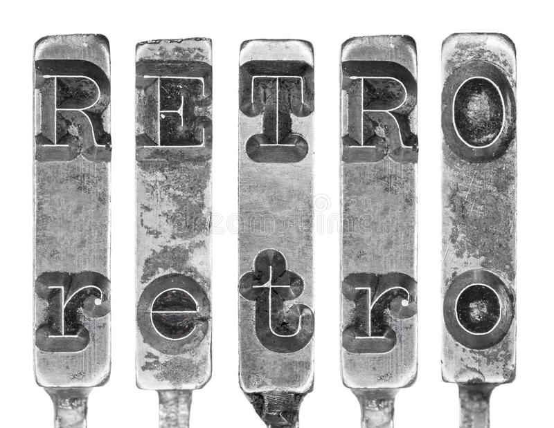 Word RETRO in Old Typewriter Typebar Letters Isolated on White. Grungy, retro typography design element. Macro shot of the word RETRO on vintage typewriter type royalty free stock photography