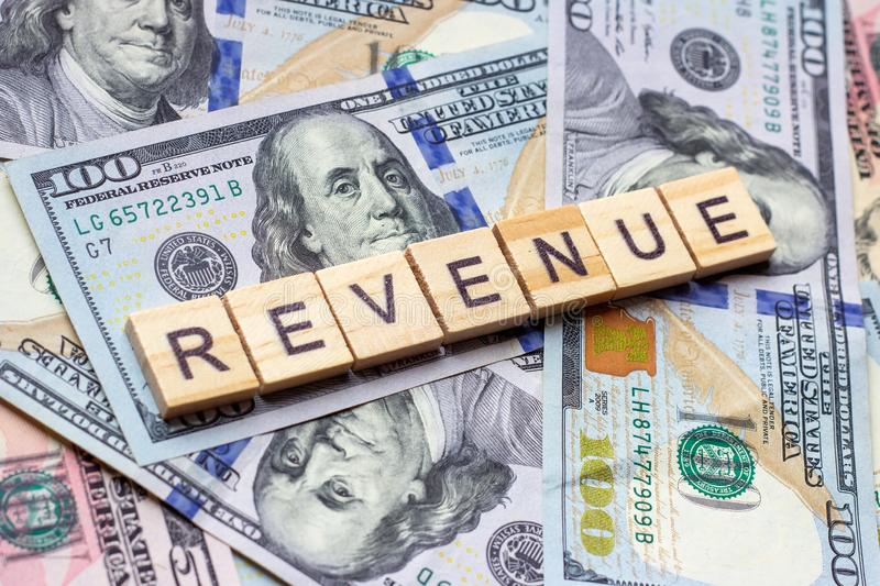 The word revenue on dollar usa background. Profit and business growth concept. stock photos