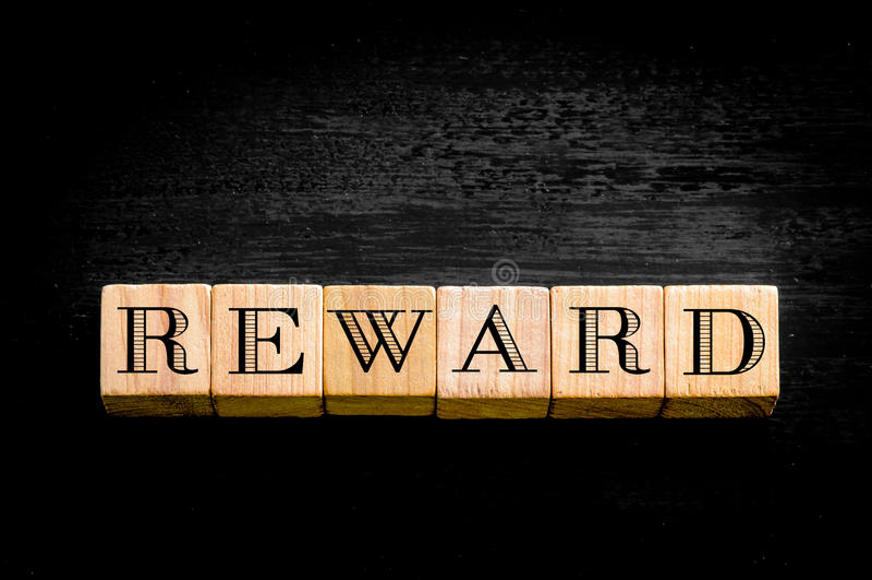 Word Reward isolated on black background royalty free stock image