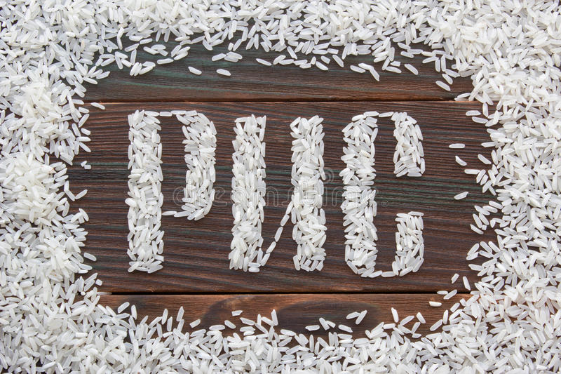 The word rice written letters of rice on a wooden board royalty free stock photography