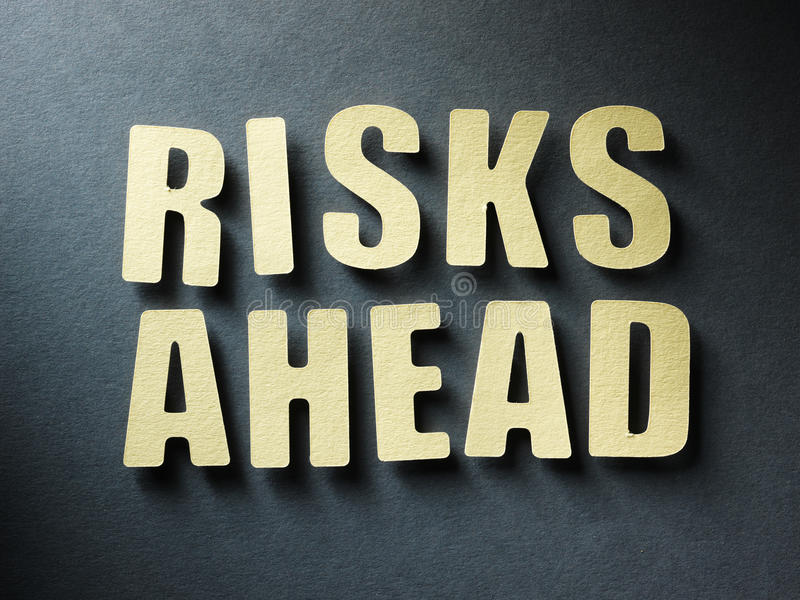 The word Risks Ahead on paper background royalty free stock photo