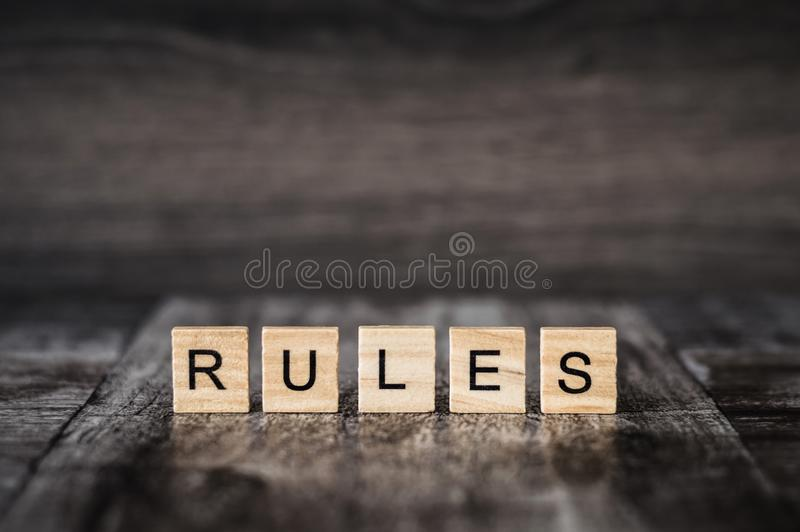The word rules made of bright wood cubes with black letters on a royalty free stock images