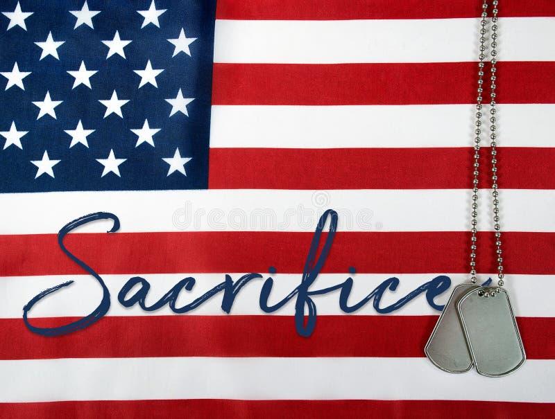 Word sacrifice with dog tags stock photo