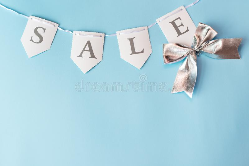 Word sale on blue background with copy space. trade concept stock images