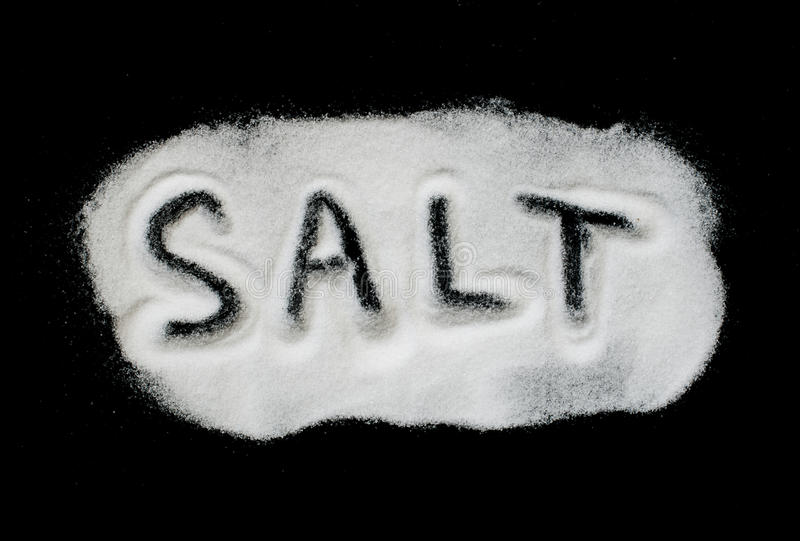 Word Salt on black background stock images