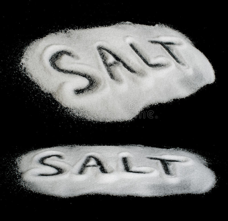 Word Salt on black background stock image