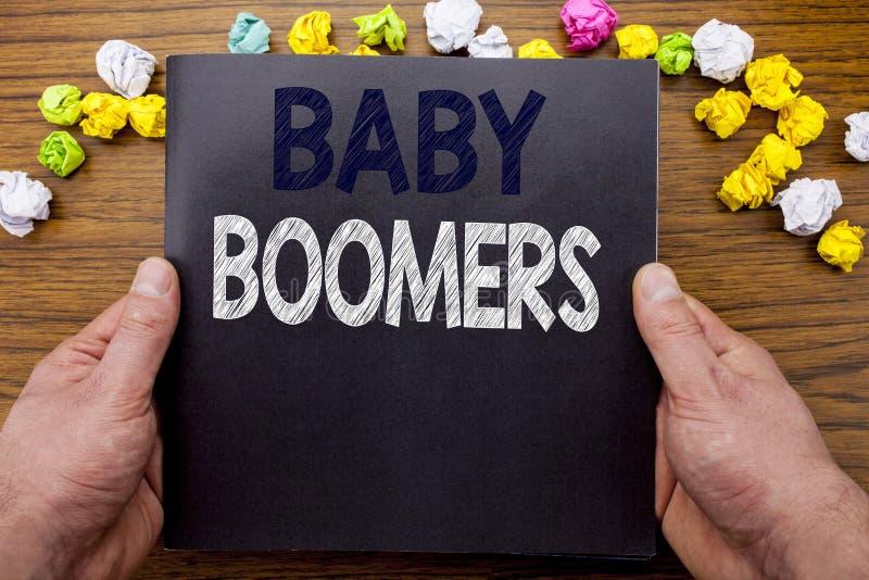 Word, schrijvende Baby Boomers Bedrijfsconcept voor Demografische die Generatie op het boek van het blocnotenotitieboekje op het  stock afbeeldingen