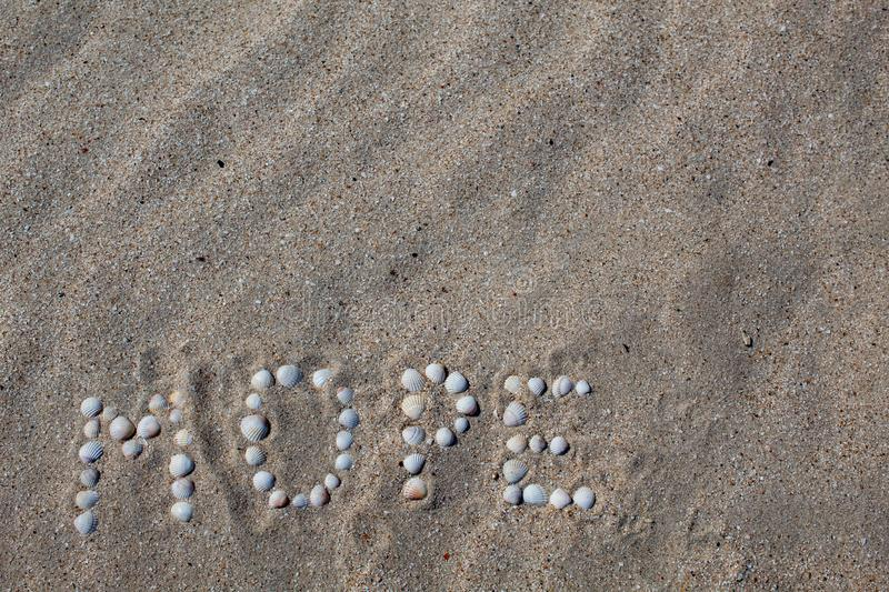 The word sea, in Russian, is laid out on the sand with shells. stock image