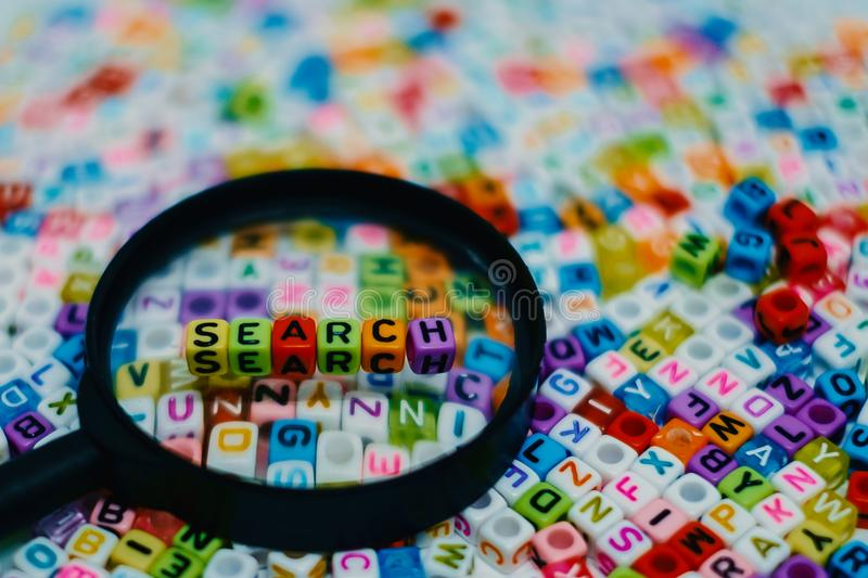 Word `SEARCH` on the magnifying glass royalty free stock photography