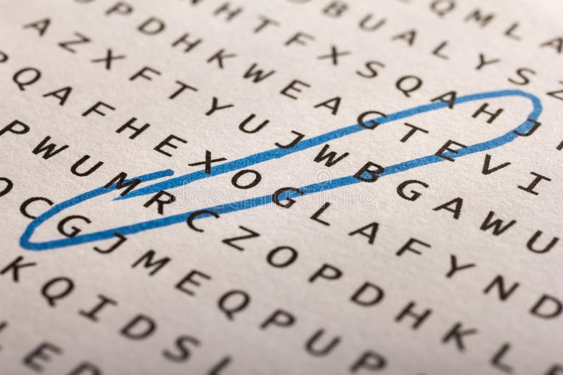 Word search, puzzle. Concept about finding, growth, success. Word search, puzzle. Close up of letters on canvas. Concept about finding, growth, success royalty free stock photo