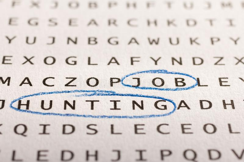 Word search, puzzle. Concept about finding, job hunting, unemplo. Word search, puzzle. Close up of letters on canvas. Concept about finding, job hunting stock photo