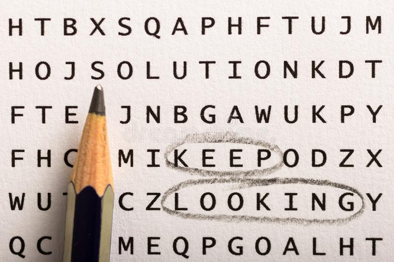 Word search, puzzle. Concept about finding, keep looking, persistence. Word search, puzzle. Close up of letters on canvas. Concept about finding, keep looking stock photos