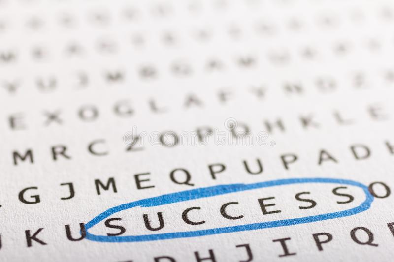 Word search, puzzle. Concept about finding, success, business. Word search, puzzle. Close up of letters on canvas. Concept about finding, success, business stock image
