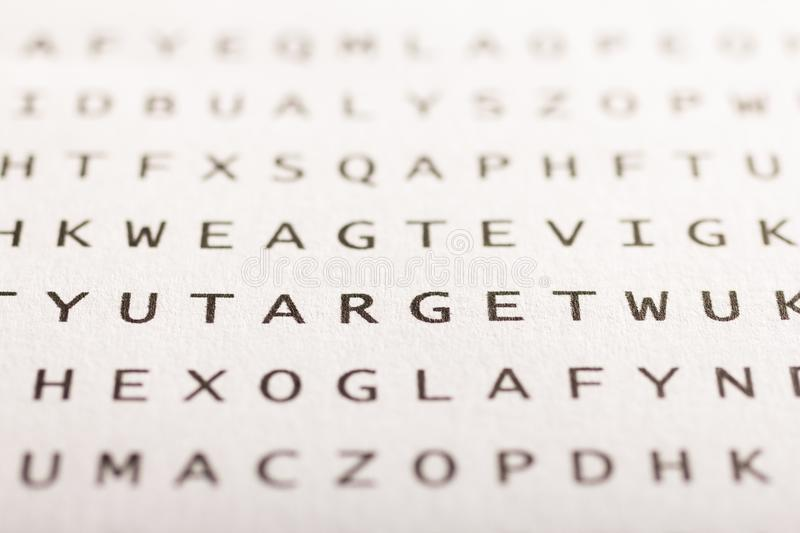 Word search, puzzle. Concept about finding, target. Word search, puzzle. Close up of letters on canvas. Concept about finding, target royalty free stock image
