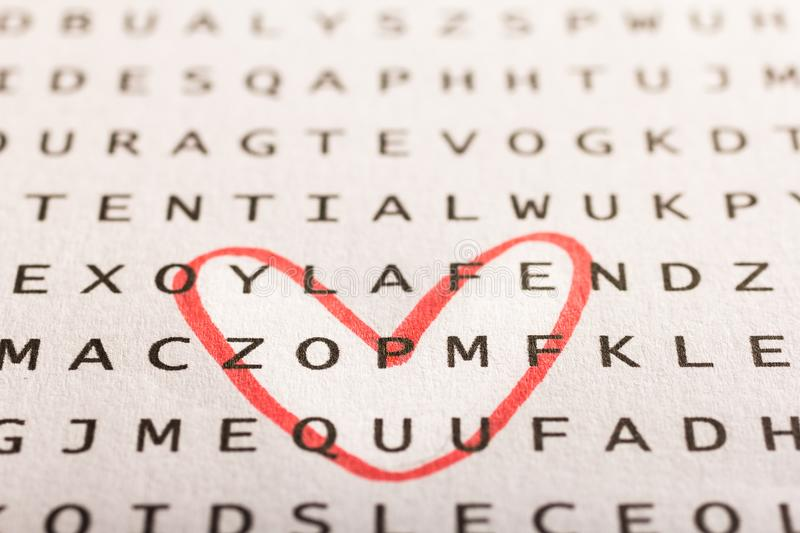 Word search, puzzle. Concept about finding, you, me. Word search, puzzle. Close up of letters on canvas. Concept about finding, you, me royalty free stock photo