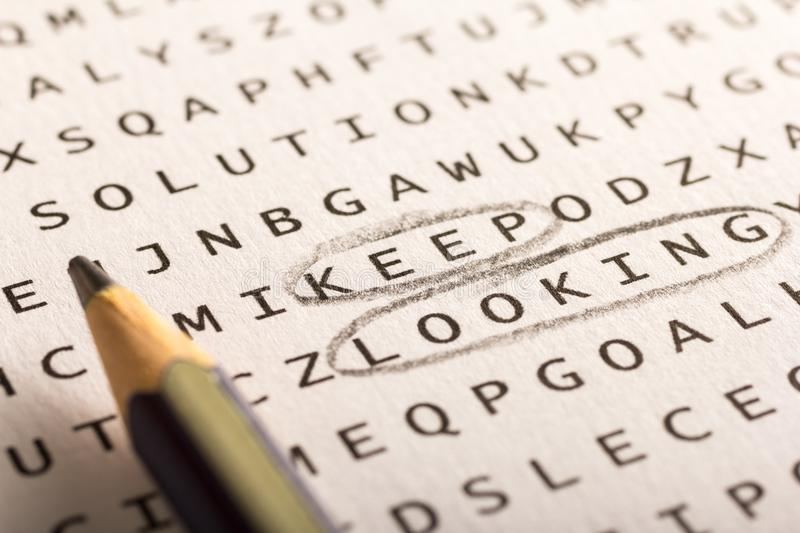 Word search, puzzle. Concept about finding, keep looking, persis. Word search, puzzle. Close up of letters on canvas. Concept about finding, keep looking royalty free stock images