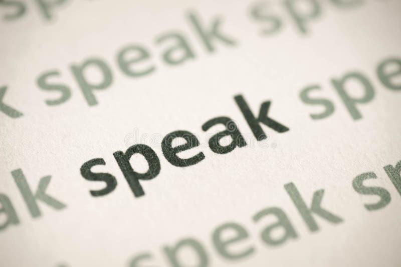 Word speak printed on paper macro royalty free stock images