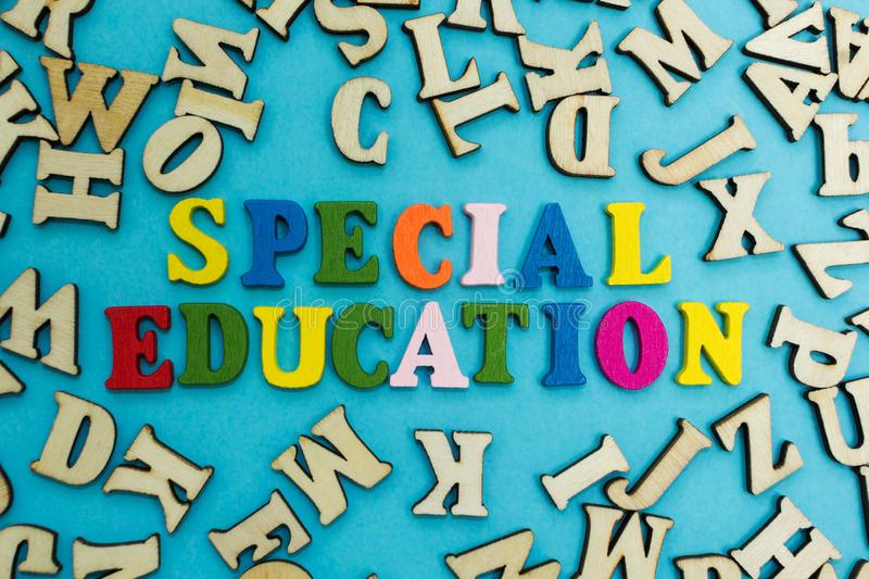 The word `special education` is laid out from multicolored letters on a blue background.  royalty free stock photo