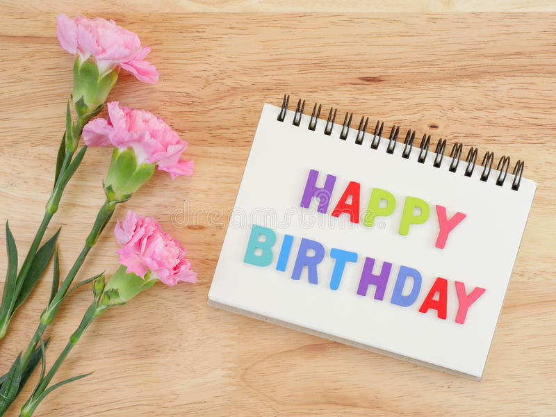 Word spell Happy Birthday and Carnation flower 2 stock photos
