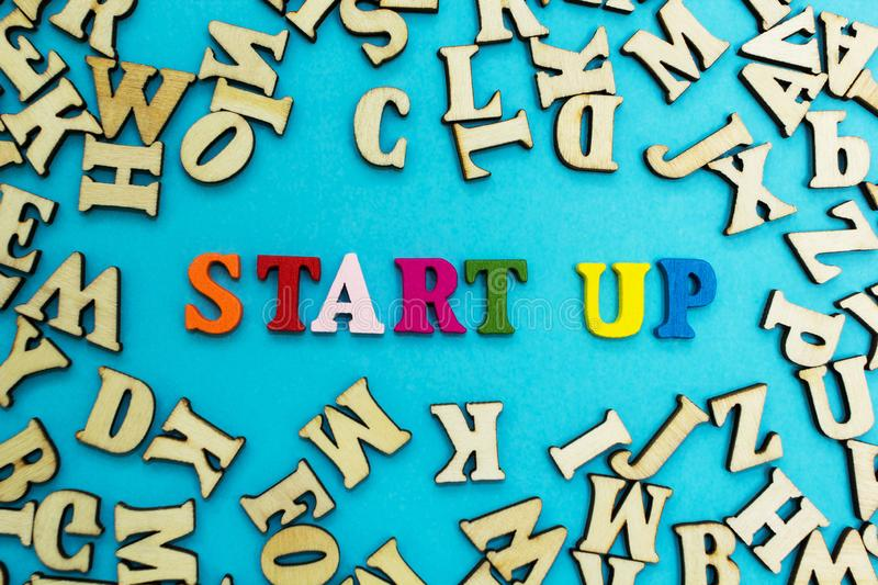 The word `start up` is laid out from multicolored letters on a blue background.  royalty free stock images