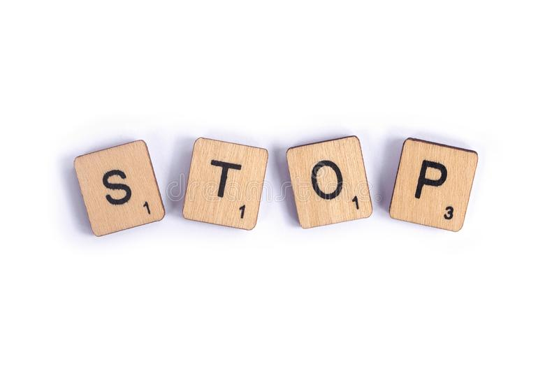 The word STOP. LONDON, UK - JULY 7TH 2018: The word STOP, spelt with wooden letter Scrabble tiles, on 7th July 2018 royalty free stock photos